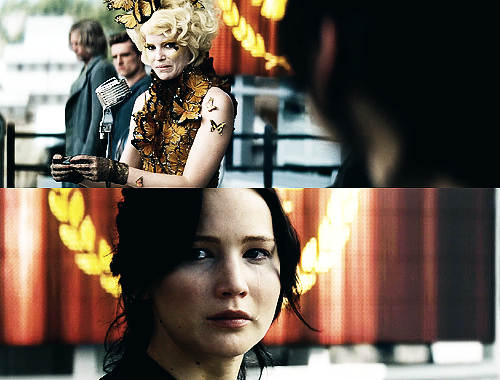 """The reaping takes only a minute. Effie, shining in a wig of metallic gold, lacks her visual verve. She has to claw around the girl's reaping ball for quite a while to snag the one of paper that everyone know has my name on it"". I can't watch this part."