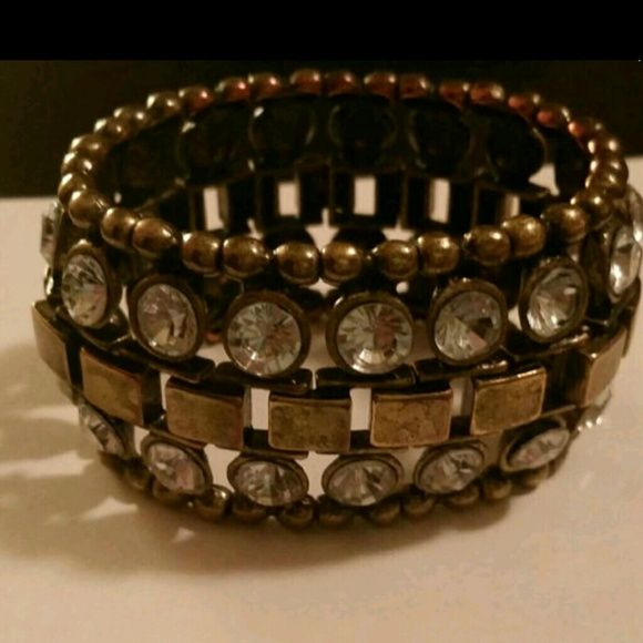 Bracelet This braclet is metal with a nice design to it,it is stretchy and the rhinestones add nice details. Overall it's really a beauty! Fashion Jewelry.   -No Trades -No Holds -For Offers please use OFFER button Jewelry Bracelets