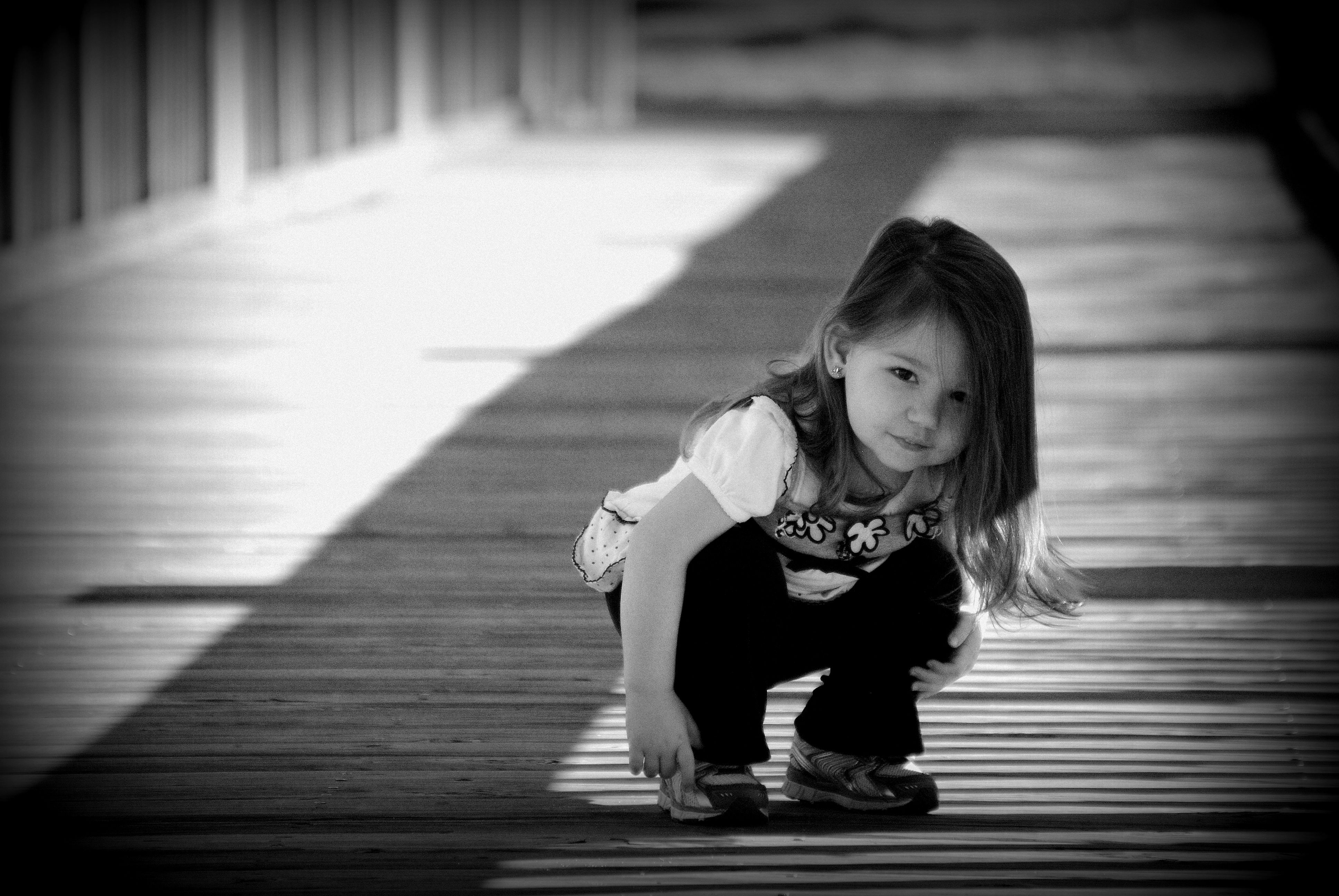 Our little girl on a pier in town.