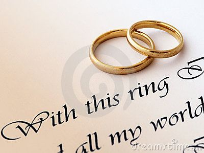 Two Wedding Rings On A Paper With Text Of Vow