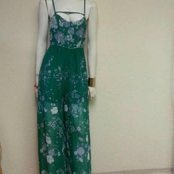 Free People green floral jumpsuit Free People jumpsuit in a beautiful green color. NWT. Free People Pants Jumpsuits & Rompers