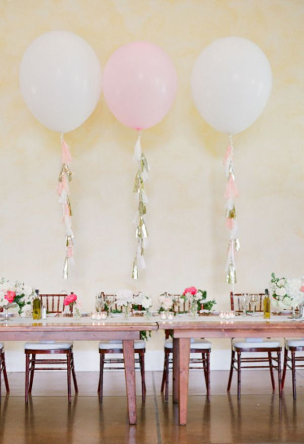 Pink and white balloons, bright pink florals, wooden table // KT Merry