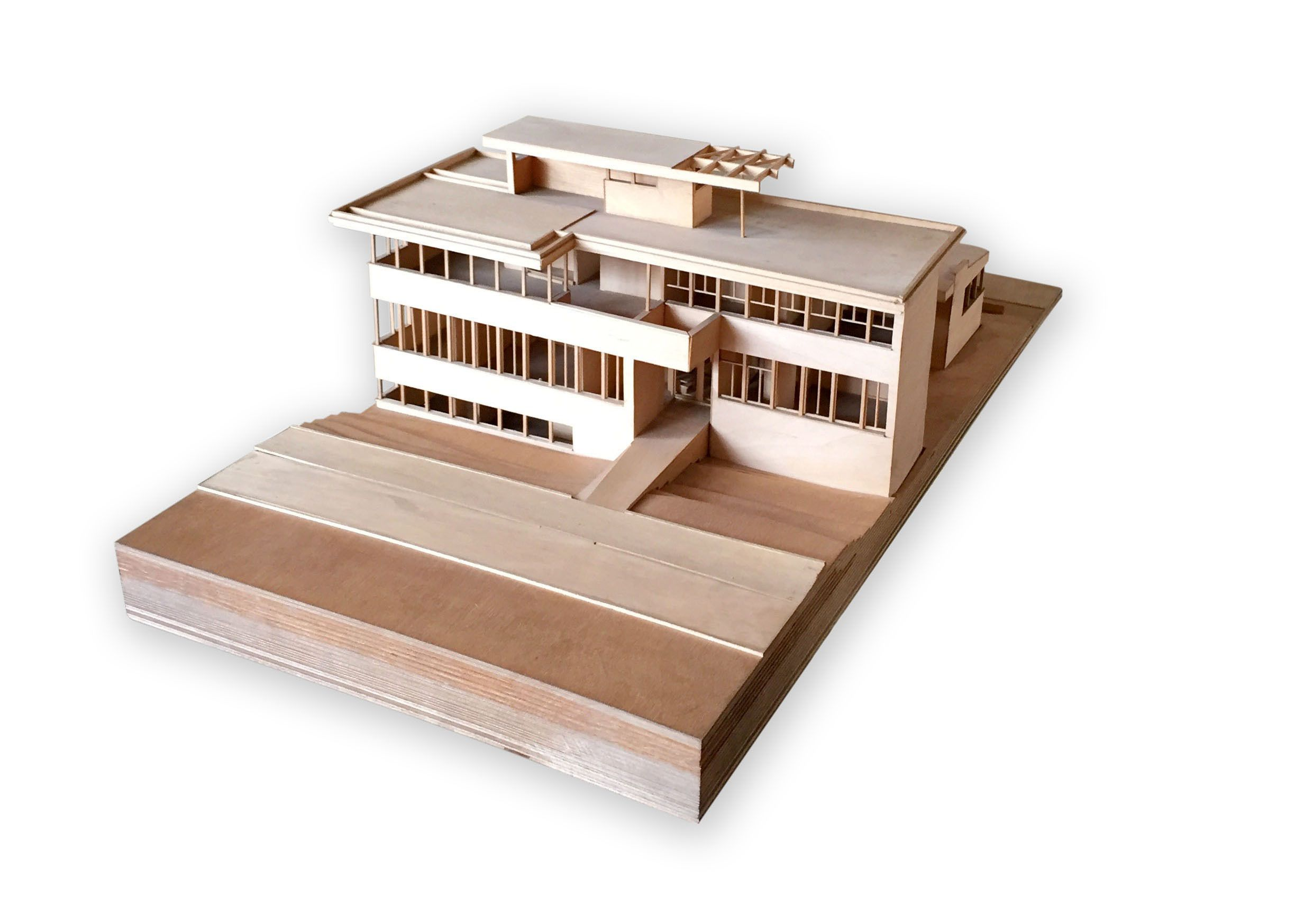 Perched On A Piano Towards The Front Of The House Is A Wooden Model That Was