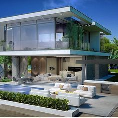 a white house with huge glass fronts and a pool in front of the house - Huge Modern Houses