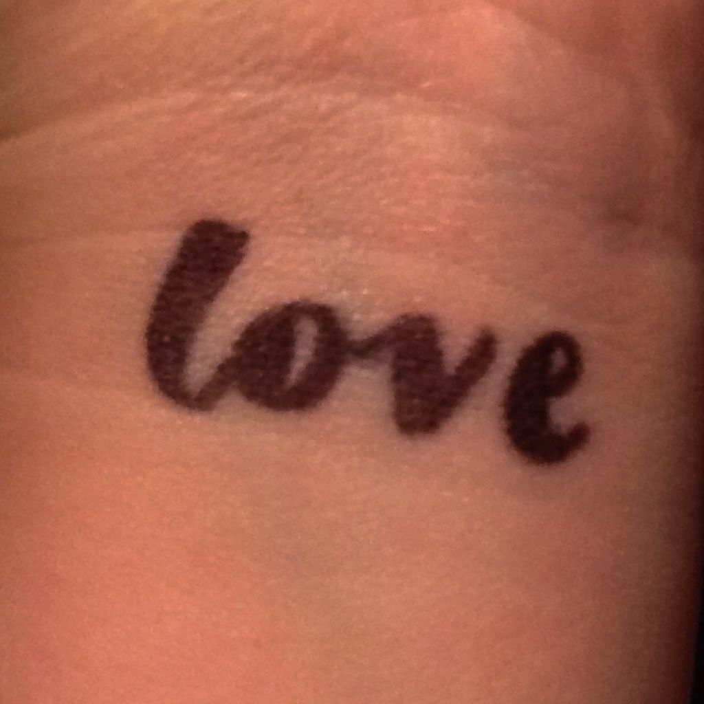 Photo of Semi-permanent Sharpie Tattoo! > Draw your design. I did 'love' in cursive on my…