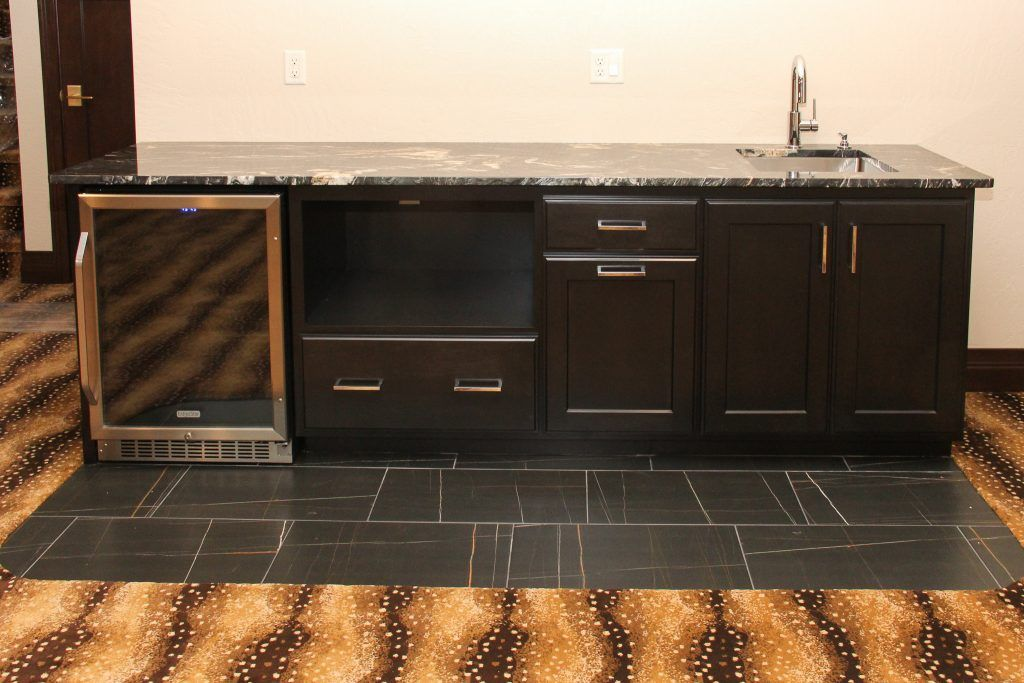 Brown And Bronze Tile Flooring Of A Wet Bar