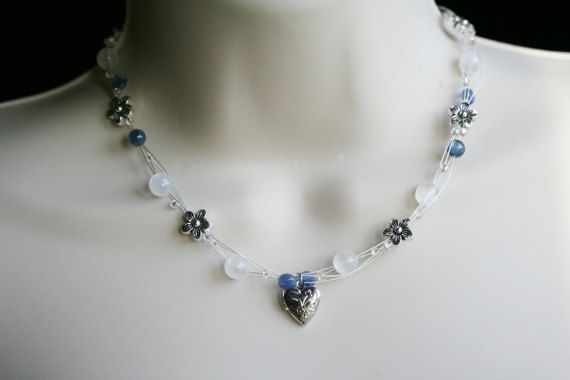 Unique floating wire necklace in white, blue and antique silver! It carries a high vibration and will bring Divine Light and deep healing to you with Blue Kyanite and White Selenite!