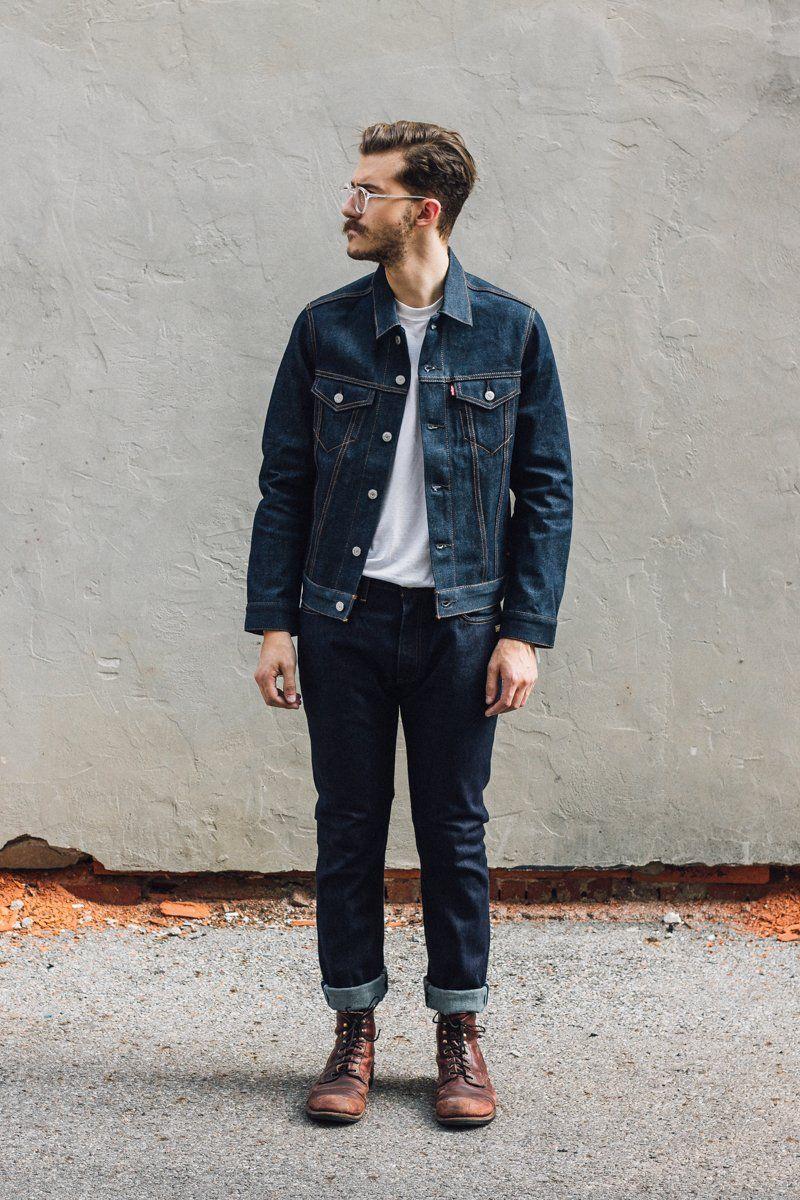 dark blue denim jacket white tee dark blue jeans brown