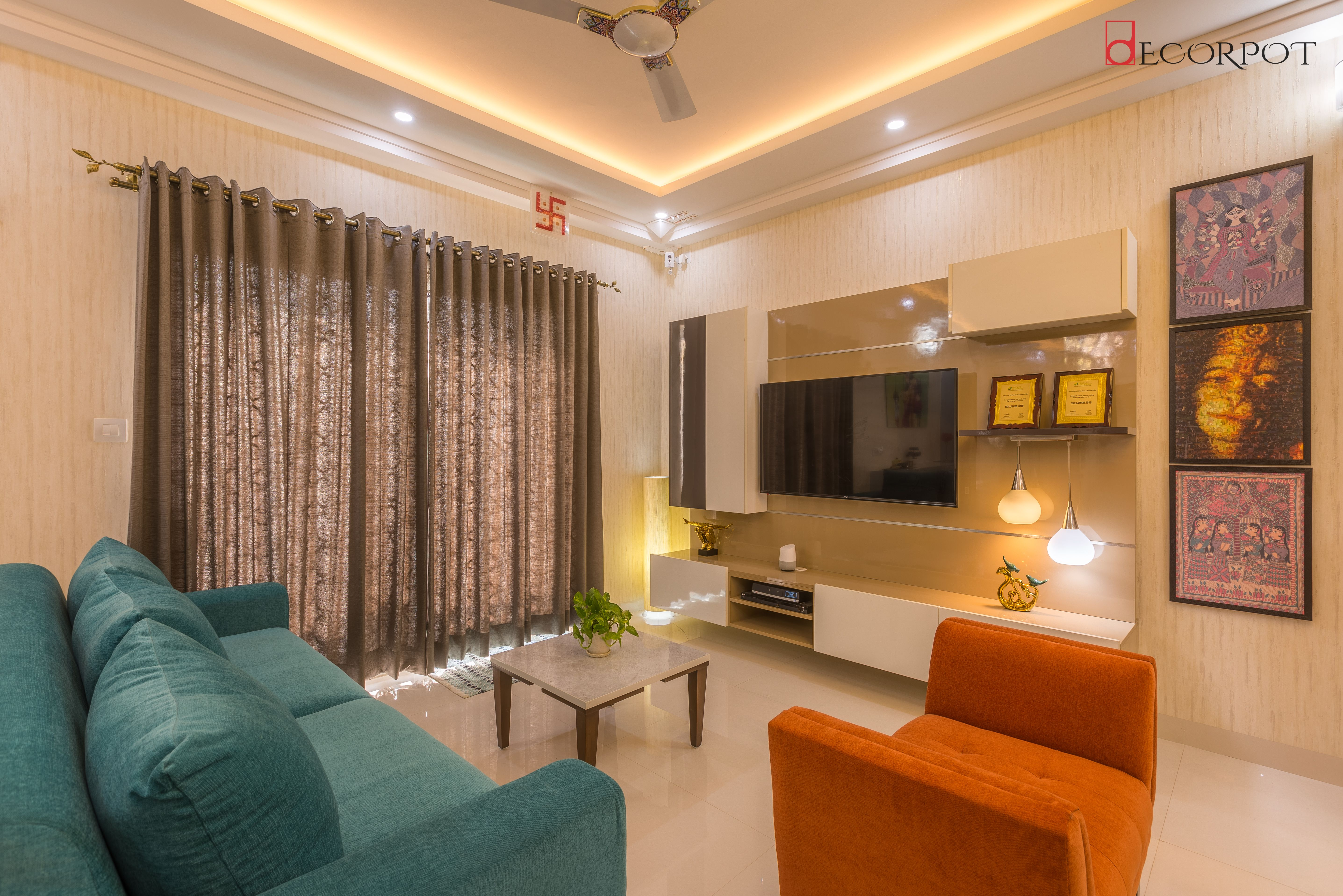 From the foyer sitting of this Decorhome, you mark your way to its entertainment area. A well lit space with vibrant colored furniture to keep up the liveliness!!