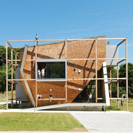 Timber frame surrounding Heri Sallis Office Off transforms the