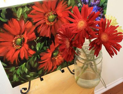 More red daisies in Flower Mound Studio. www.nancymedina.com
