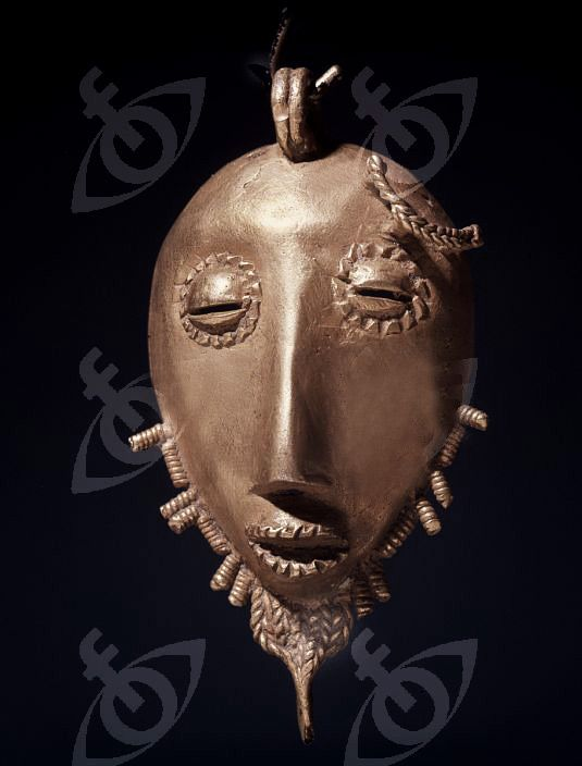 An Ashanti gold pendant in the form of a stylized head. –  Ghana-gold pendant- Ghana-439x578