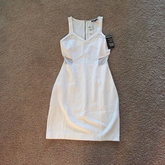 NWT Body con white dress NWT White bodycon dress with mesh around the sides and back and gold zipper up the back. Size 2 can also fit a 4. Express Dresses Mini