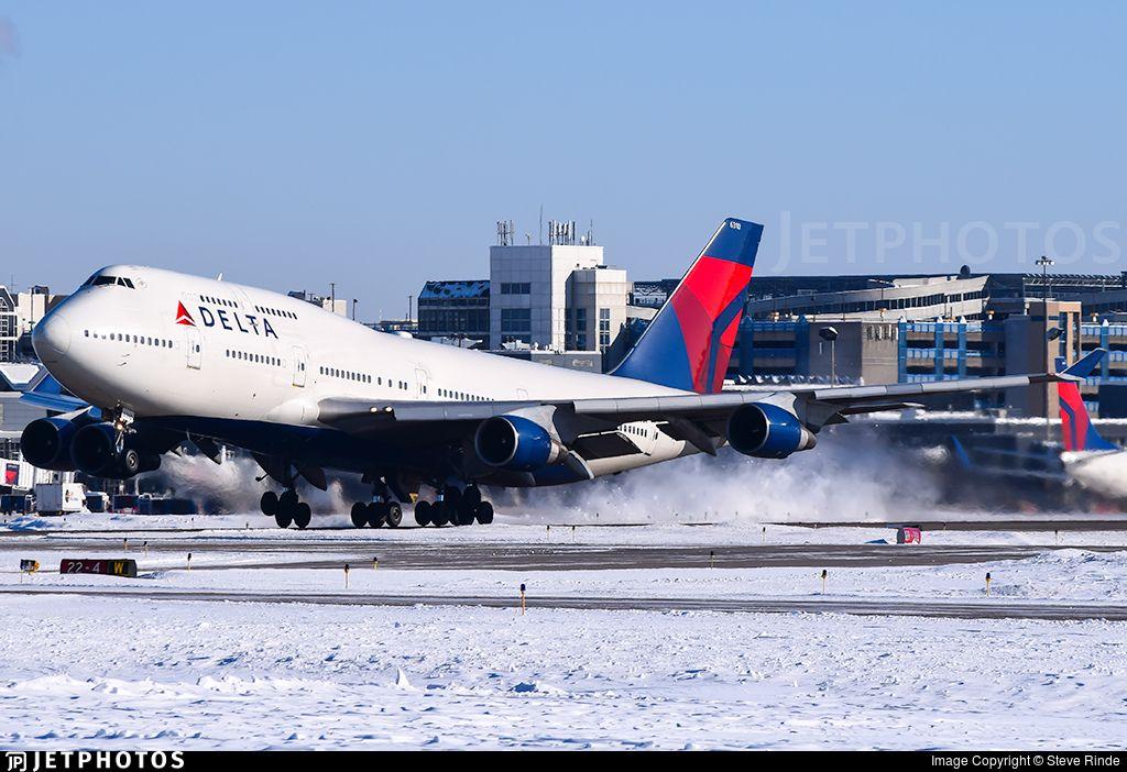 Rotating off rwy 30L.. N670US. Boeing 747451. JetPhotos