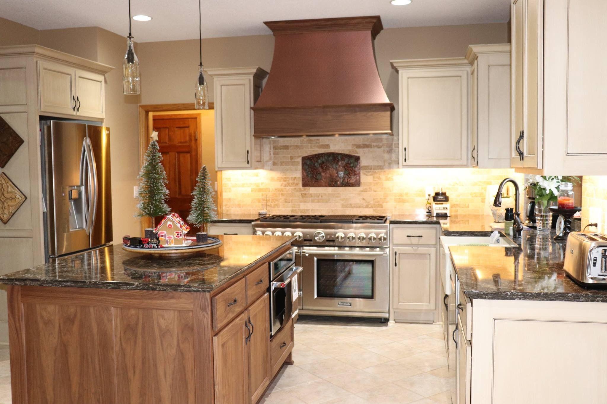 Cream Cabinets With Dark Brown Wash Walnut Island Copper Hood With Walnut Accents Kitchen Remodel Copper Hood Cream Cabinets