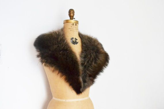 huge silver Raccoon fur collar scarf / attach clasps. $56.00, via Etsy.