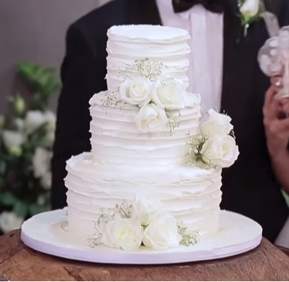 Wedding Cake at a Friend's Wedding. Love the buttercream icing and the flower decoration. Prefer leaves!