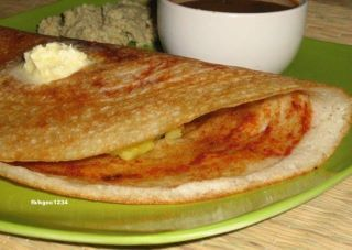 Masala Dosa - (Dosa made of batter of raw rice/black grams) and masala made of smashed potato with ginger/chilly and curry leaves