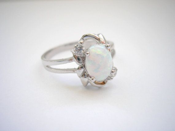 Silver tone metal classic ring with rainbow white by badgestuff, $5.00