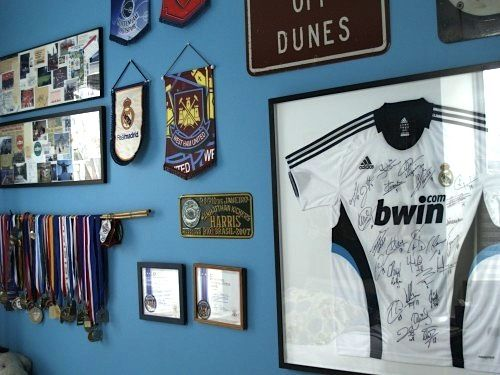 sports collection display for teen boys room