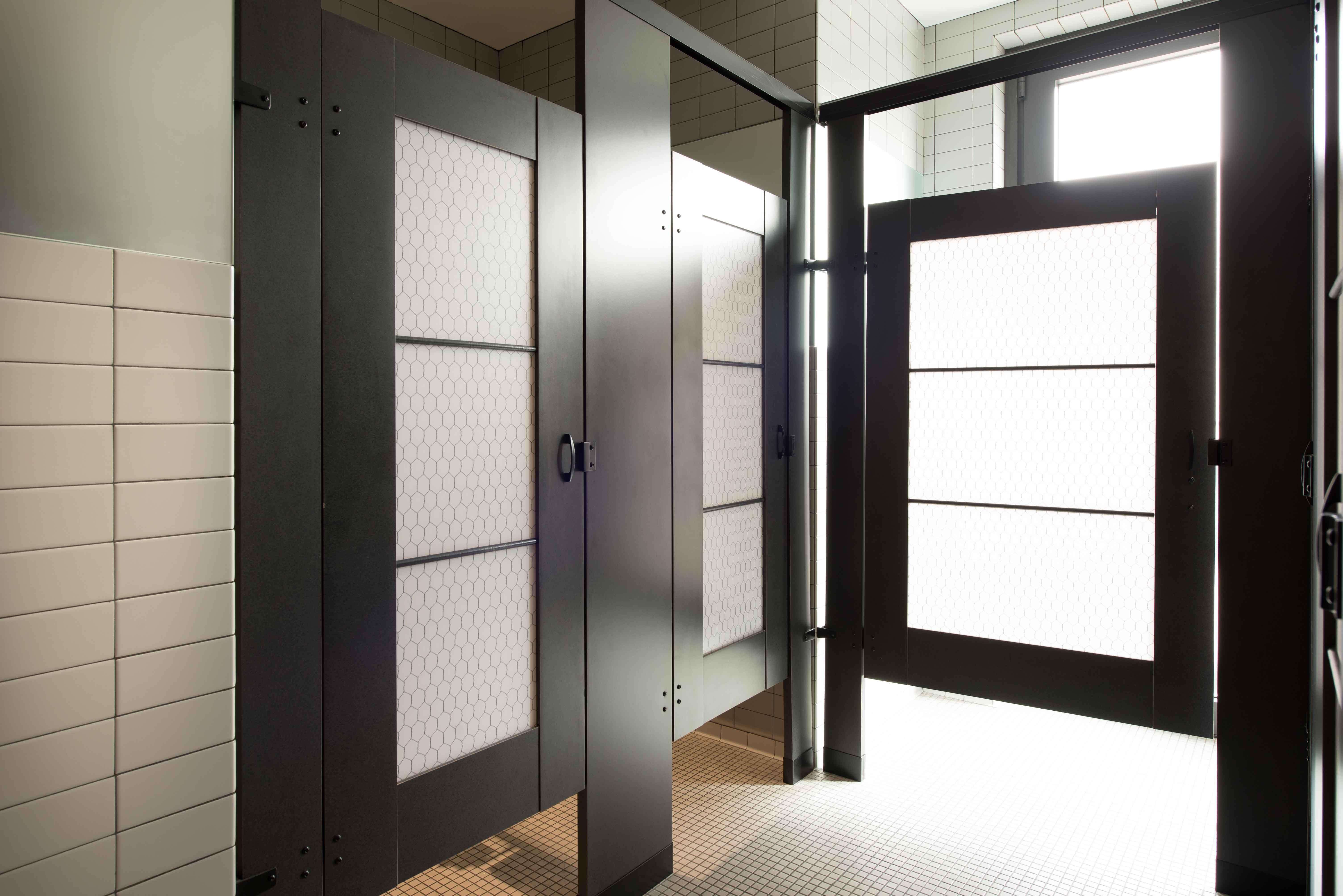 Ironwood Manufacturing laminate toilet partitions with engraved bathroom door. Unique custom public restrooms. & Ironwood Manufacturing laminate toilet partitions with engraved ...