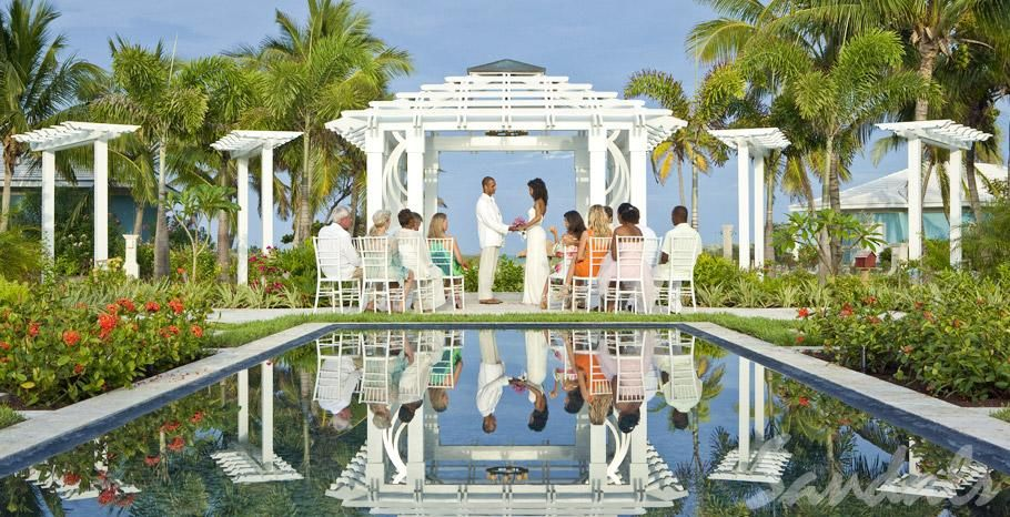 Have A Beautiful Poolside Wedding Ceremony At Sandals Emerald Bay In Exuma Bahamas