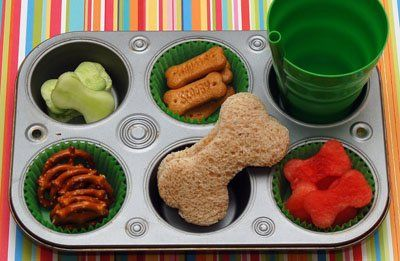 Bad to the Bone Lunch -  This neat muffin tin meal includes a bone-shaped sammy, pretzels, Scooby graham cracker snacks, bone-shaped cucumbers and mini watermelon bones.