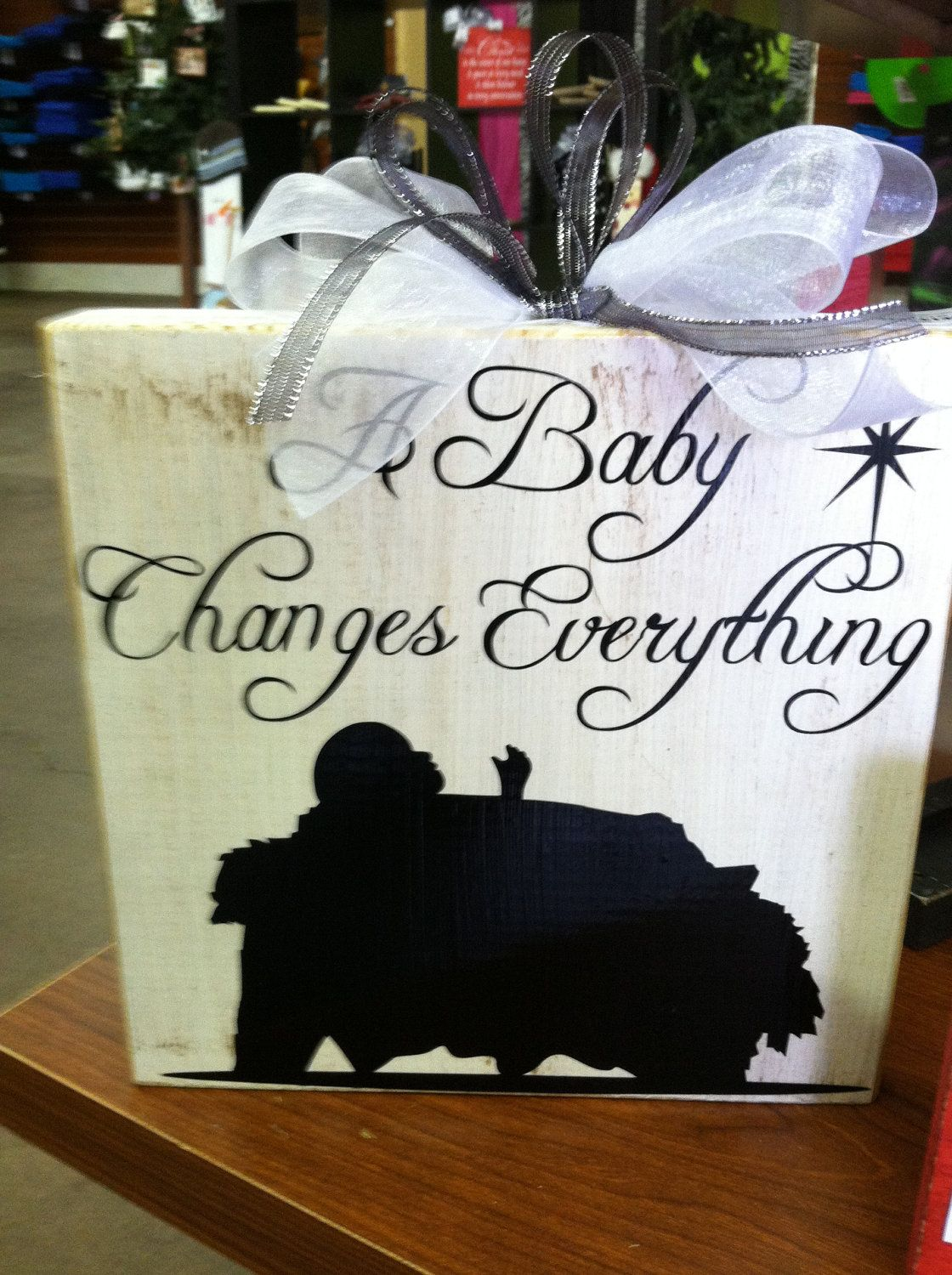 Wood Block Sign 9x9 A Baby changes everything.