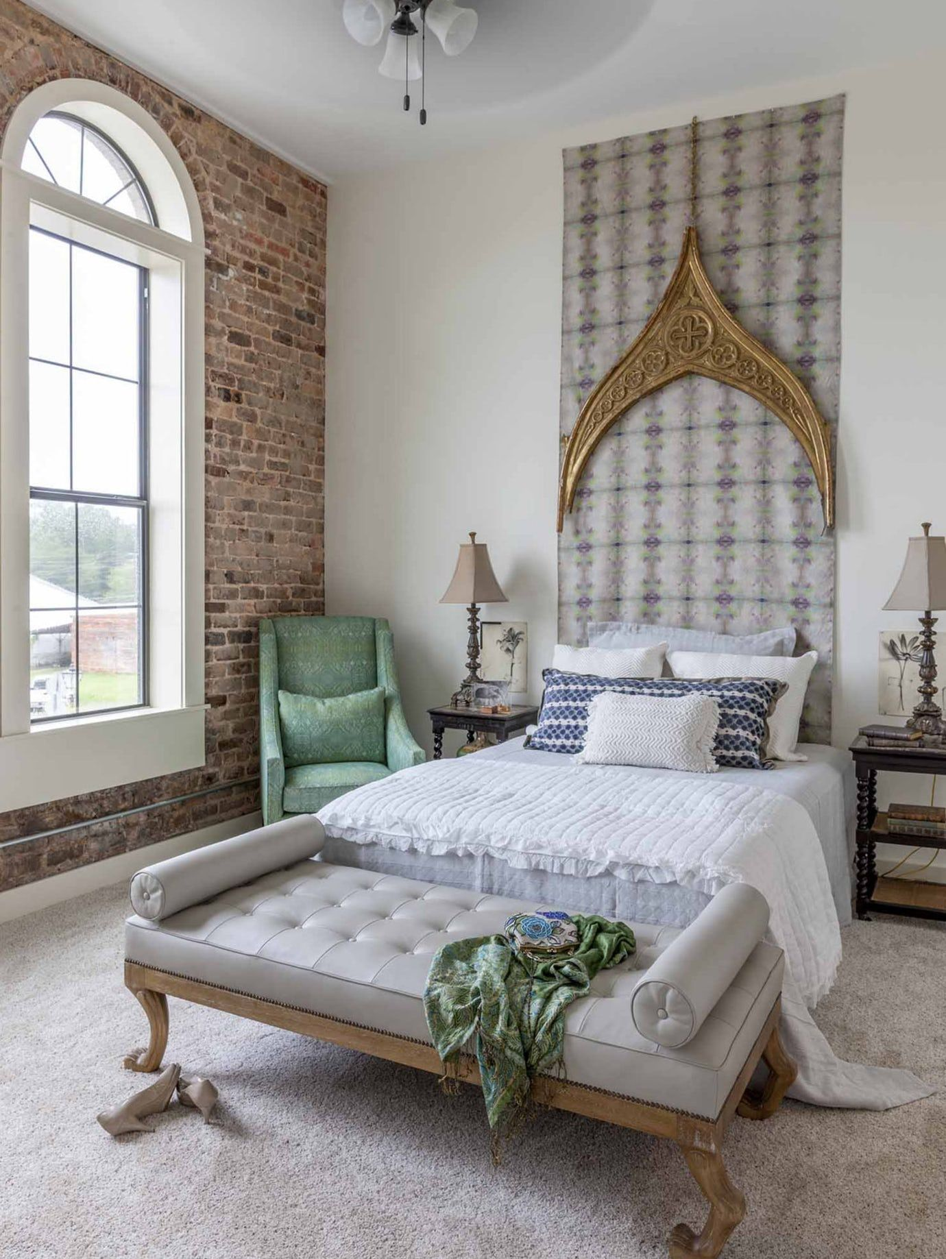 Loft Master Bedroom with exposed brick walls featuring ...