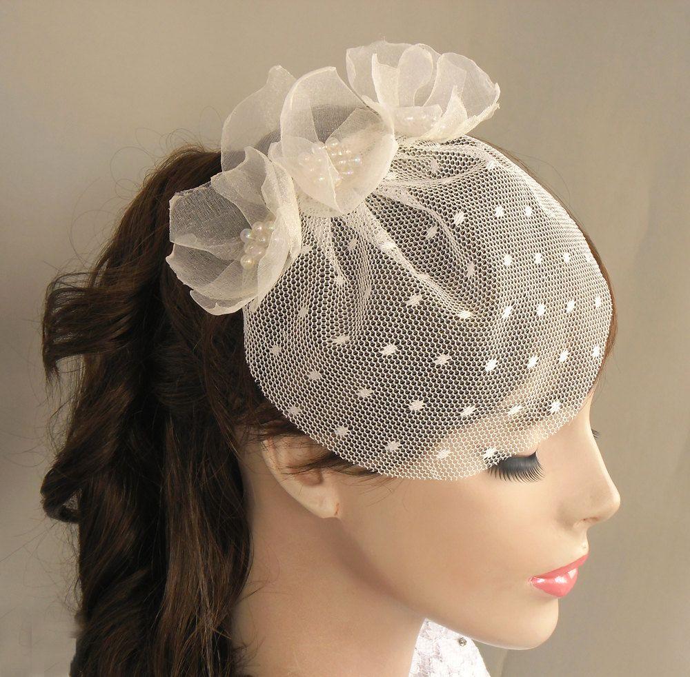 Mini bridal wedding veil organza tulle flower handmade birdcage veil. $55.00, via Etsy.