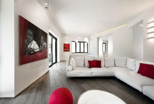 apartamento celio diseo interior minimalista blanco y rojo con toques artsticos
