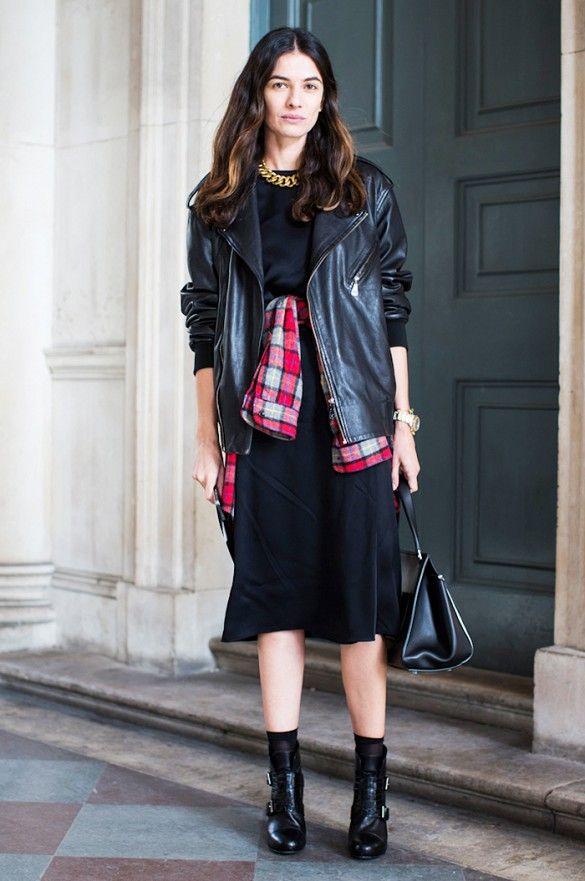 Black midi dress, plaid shirt tied around waist, and black heeled booties