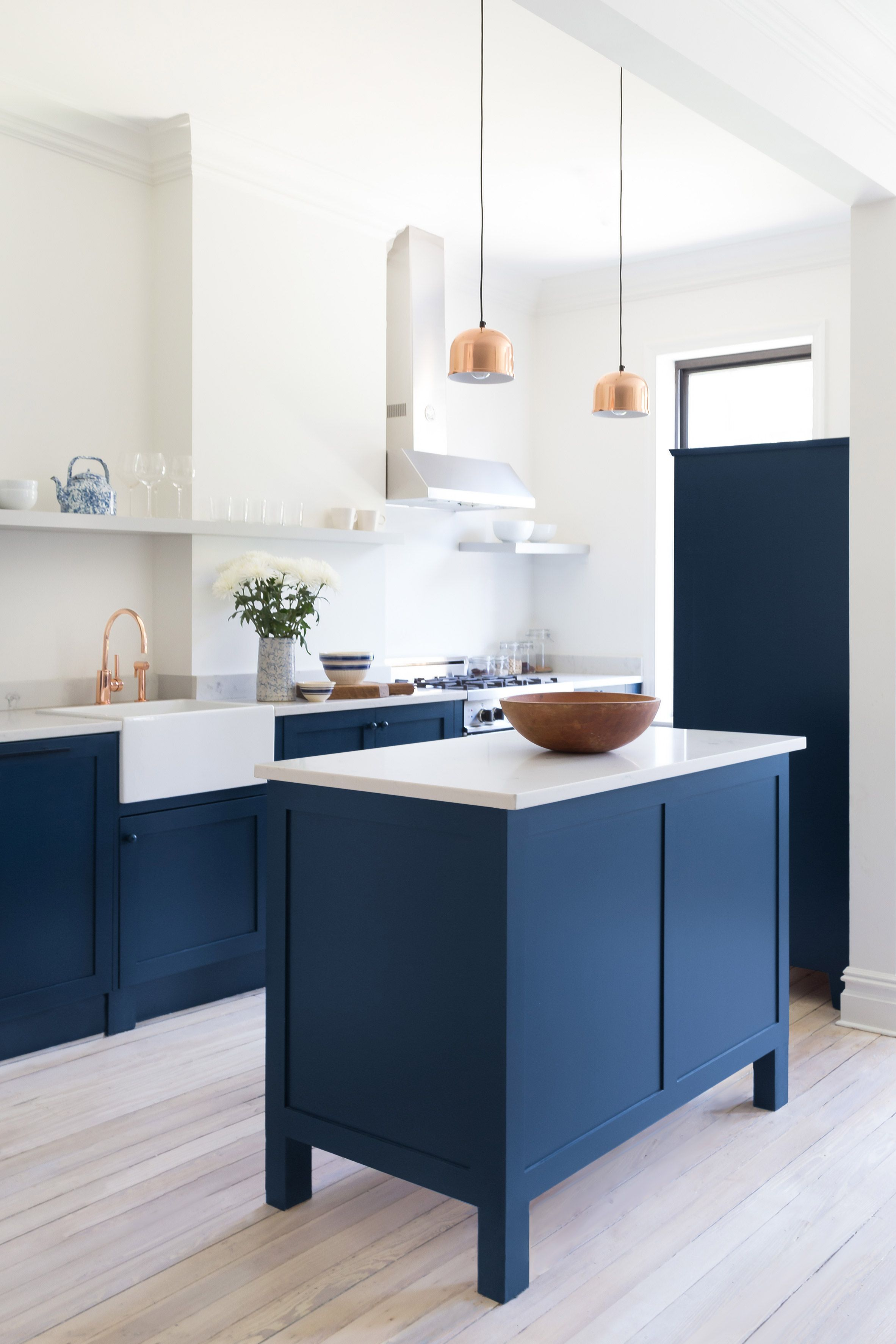White Arrow Renovates Brooklyn Rowhouse With Navy Millwork And Modernist Furniture Blue Kitchen Cabinets Assembled Kitchen Cabinets Kitchen Interior