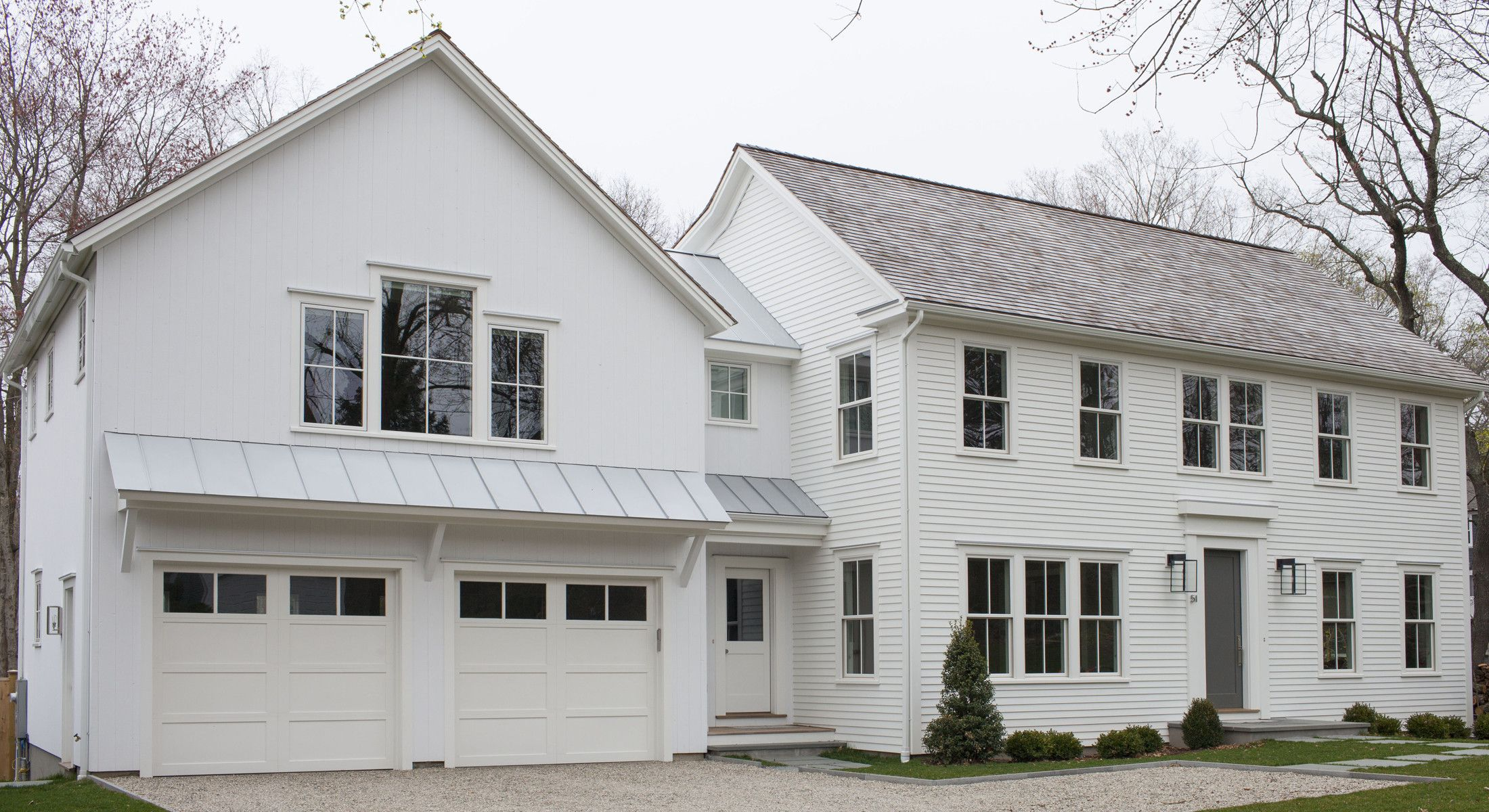 Modern farmhouse exterior with columnless roof awning for Farmhouse garage doors