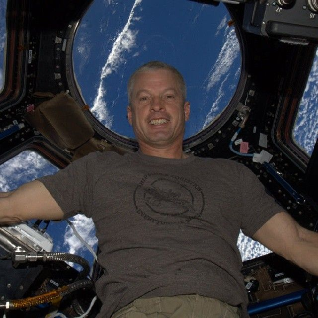 """""""Last week, NASA astronaut Steve Swanson sent the first Instagram from space. It was a selfie, naturally, taken before the ISS cupola. But what caught our eye wasn't Swanson's handsome mug or the view of Earth. It was Swanson's shirt, which features a familiar spacecraft and the words: """"Shipping & Logistics: Everything's Shiny."""""""""""