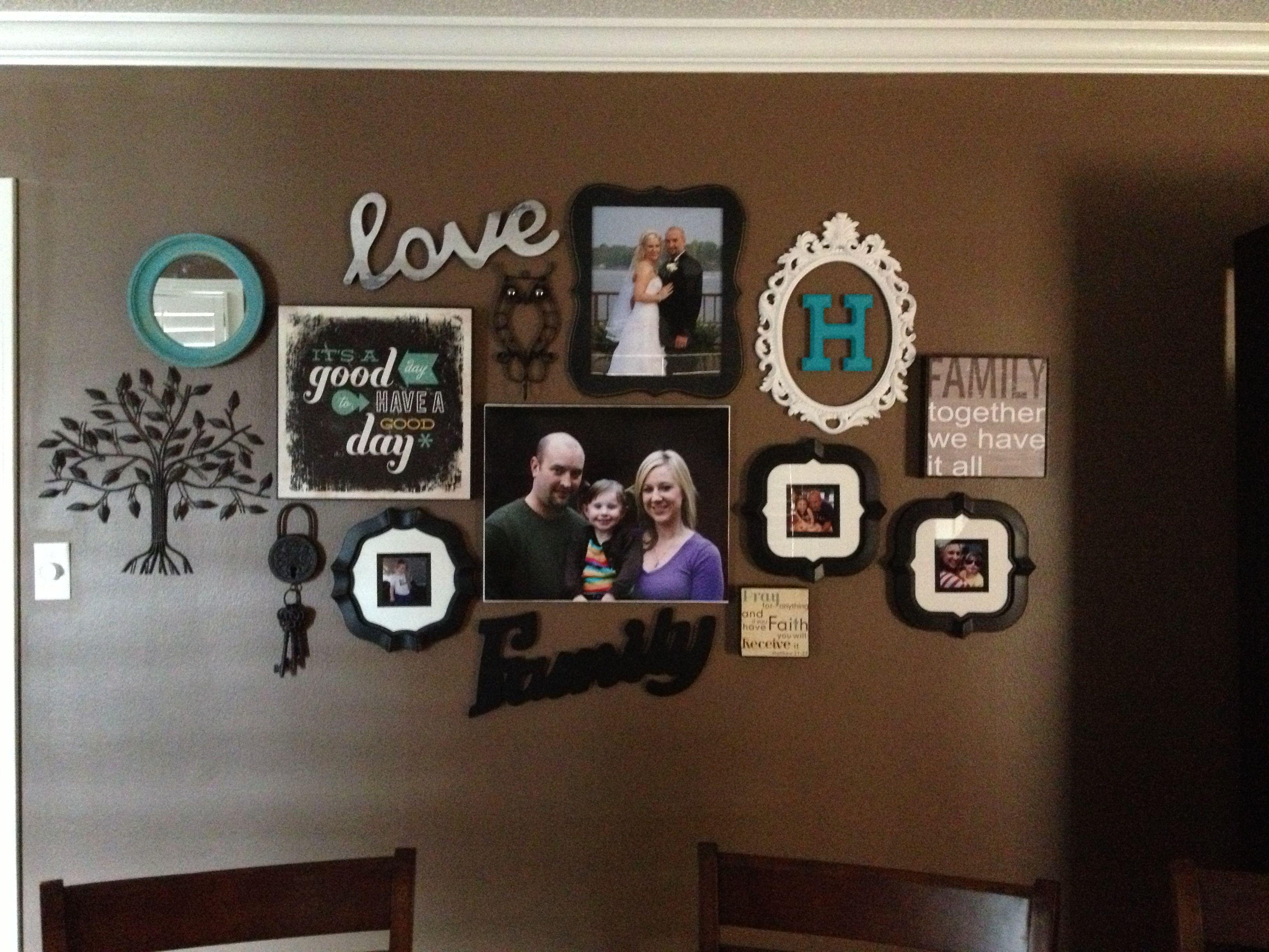 Dining room wall teal makes it pop home decor for the walls love the antique frames around wood letters love sign bright round mirror photos canvas photos and random wall dcor love it would be perfect in my amipublicfo Image collections