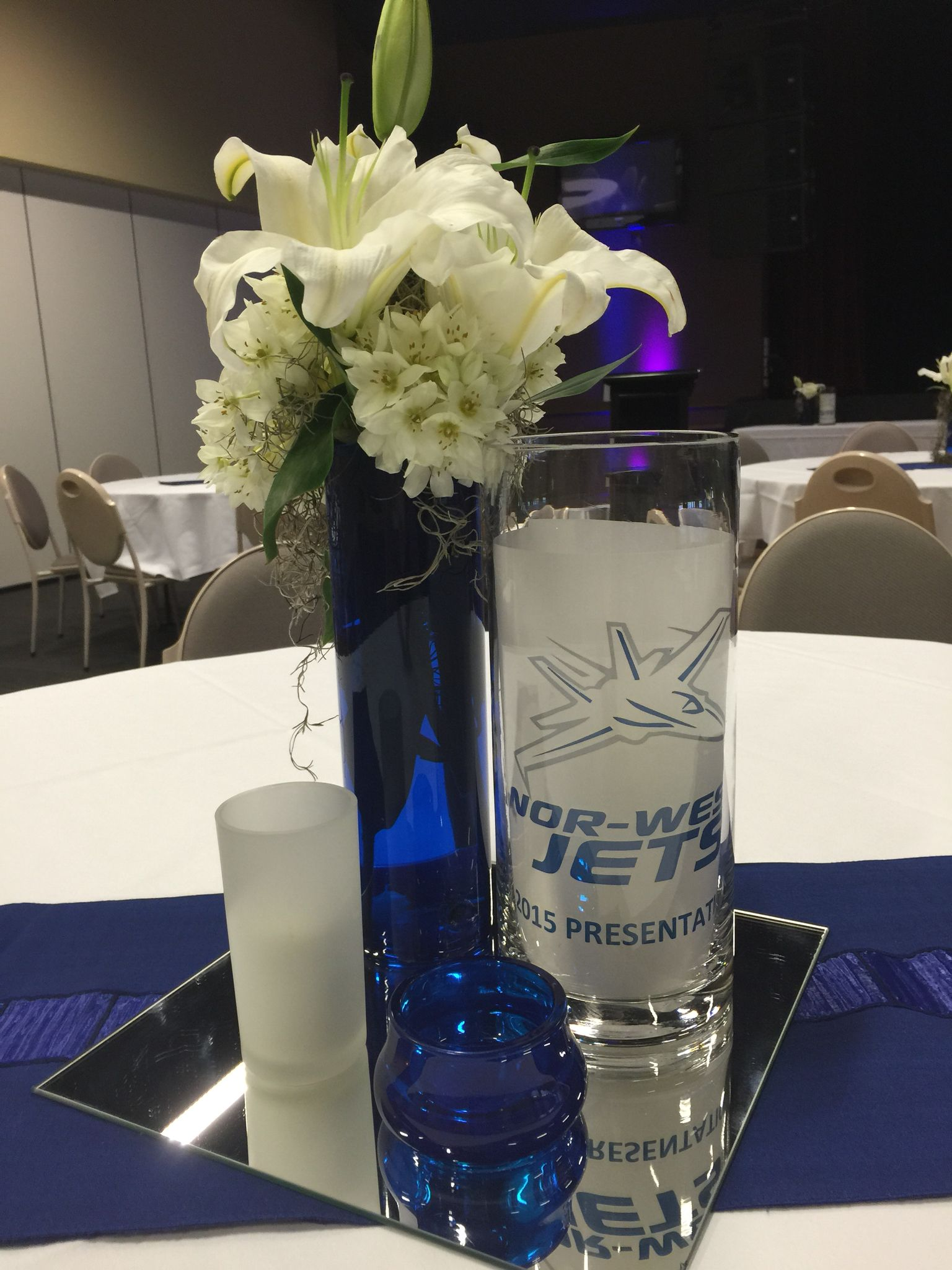 Corporate blue themed afl centrepieces by rocket event
