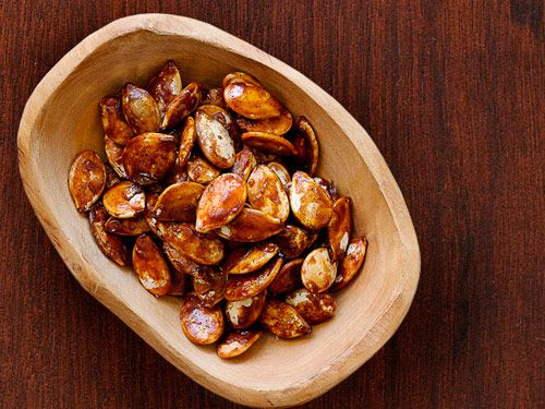 Turn roasted pumpkin seeds into a sweet treat with sugar and pumpkin-pie spice.
