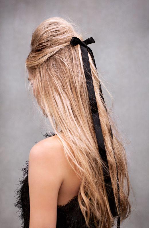 dramatic pouf half up + long, black bow.