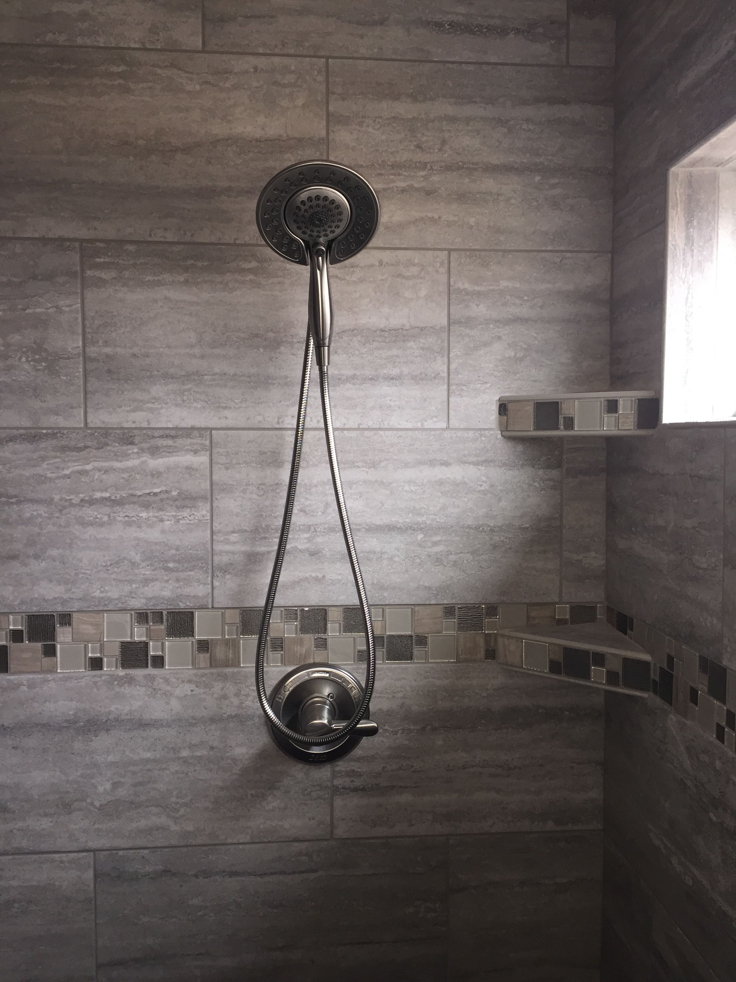 Custom Tiled Shower In A 12x24 Porcelain Tiled Staggered At 1 3 Horizontally With Glass And Stone Mosaic Accent Shower Tile Custom Tile Shower Diy Bathroom