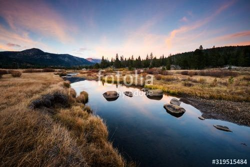 clouds reflect in the West Fork of the Carson River at sunset in Hope Valley California Beautiful clouds reflect in the West Fork of the Carson River at sunset in Hope Va...