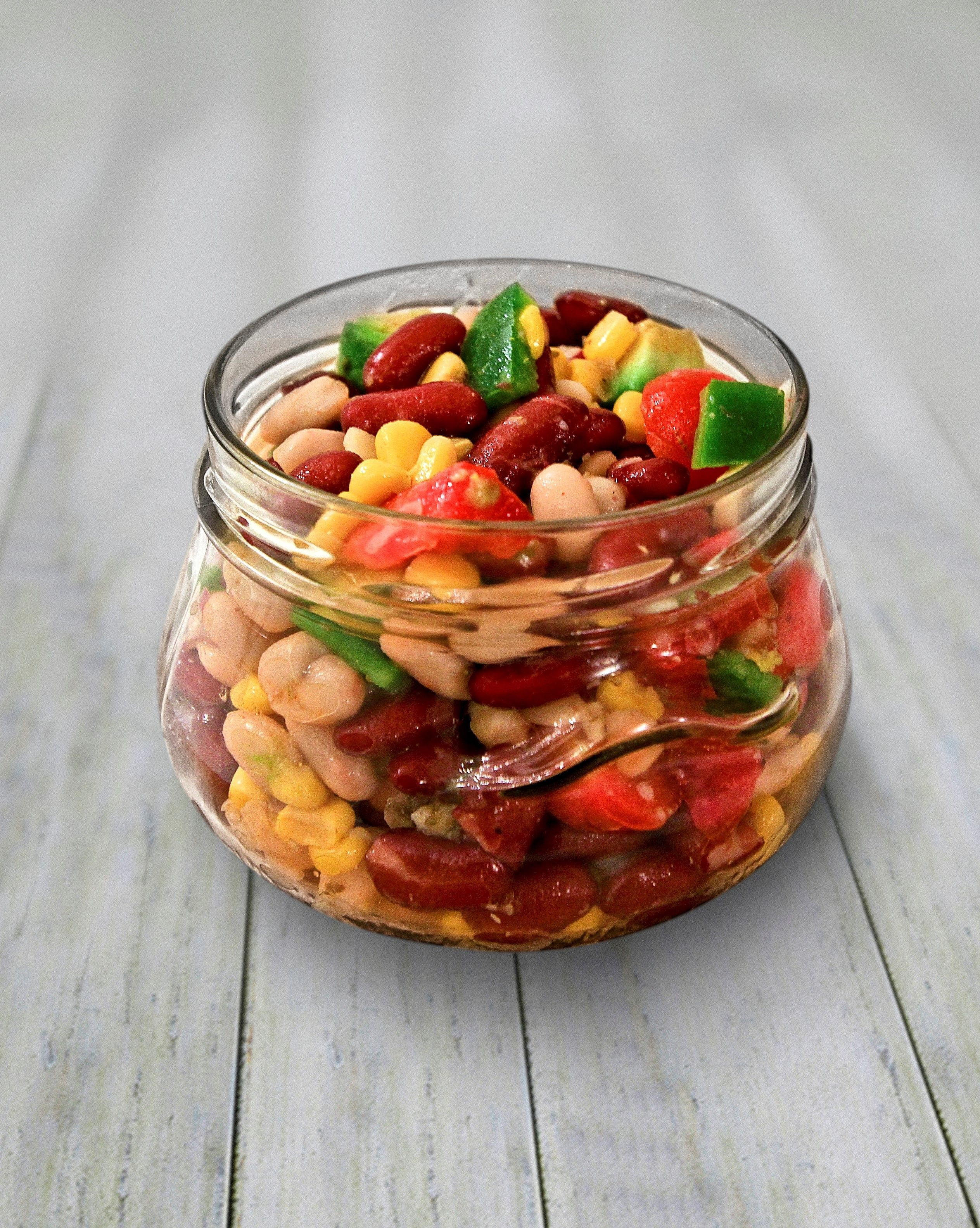 SPICY MEXICAN BEAN SALAD POT This tasty mixed bean salad has a really nice kick to it Colourful vibrant and refreshing this lunch pot has just the right amount of sweet a...