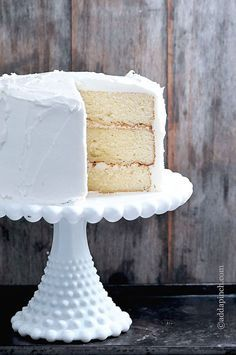 The BEST White Cake Recipe - Perfect for so many special occasions - birthdays, showers, anniversaries and even weddings! Such a well loved favorite! Try this special White Cake! ©addapinch.com