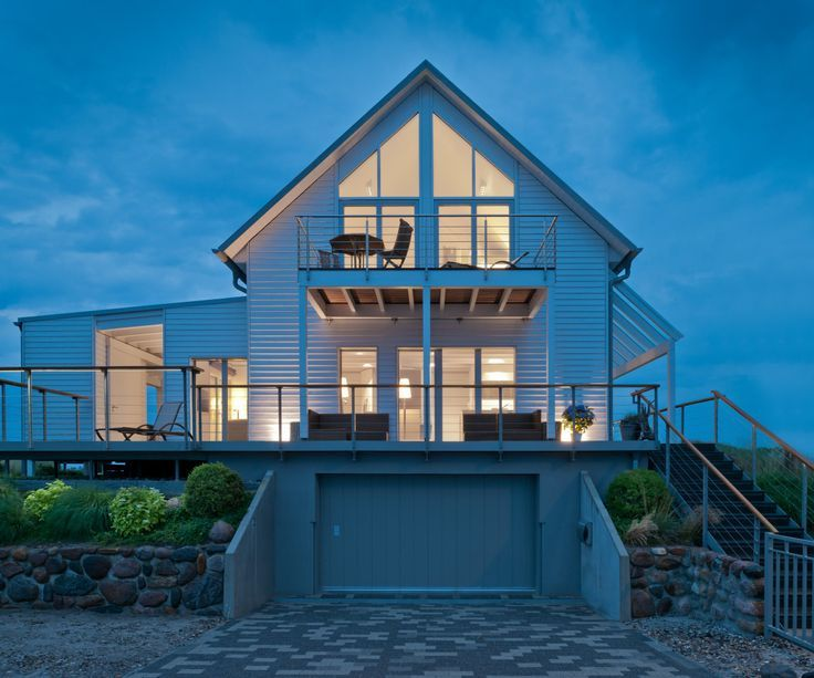 Modernes Landhaus mit Garage Haus Mommsen von Baufritz