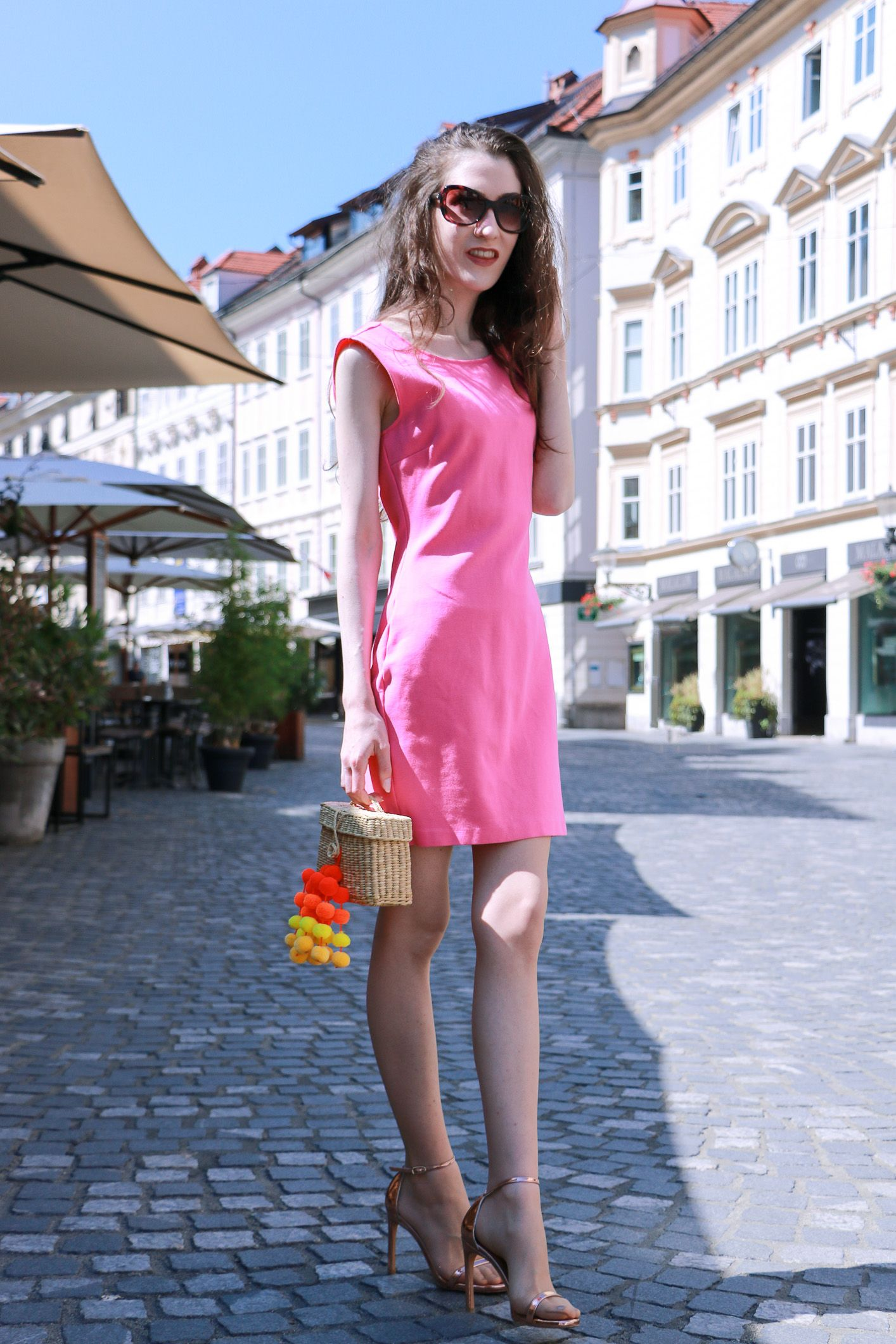 b8b53961cd10 Fashion blogger Veronika Lipar of Brunette From Wall Street sharing how to  wear head to toe pink outfit this summer