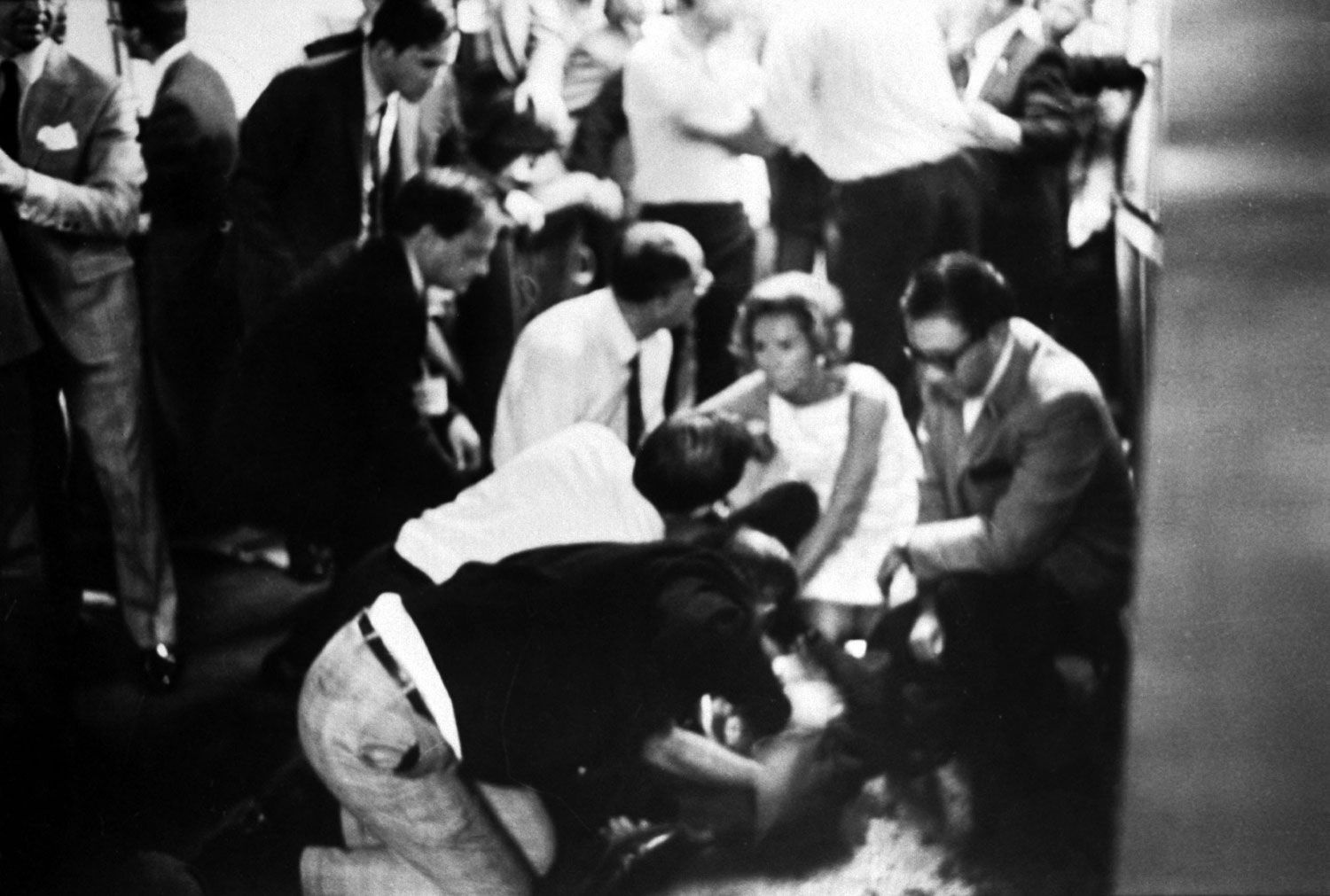 the assassination of robert f kennedy June 5, 1968: presidential candidate robert f kennedy lies on the floor at the ambassador hotel in los angeles moments after he was shot in the head.