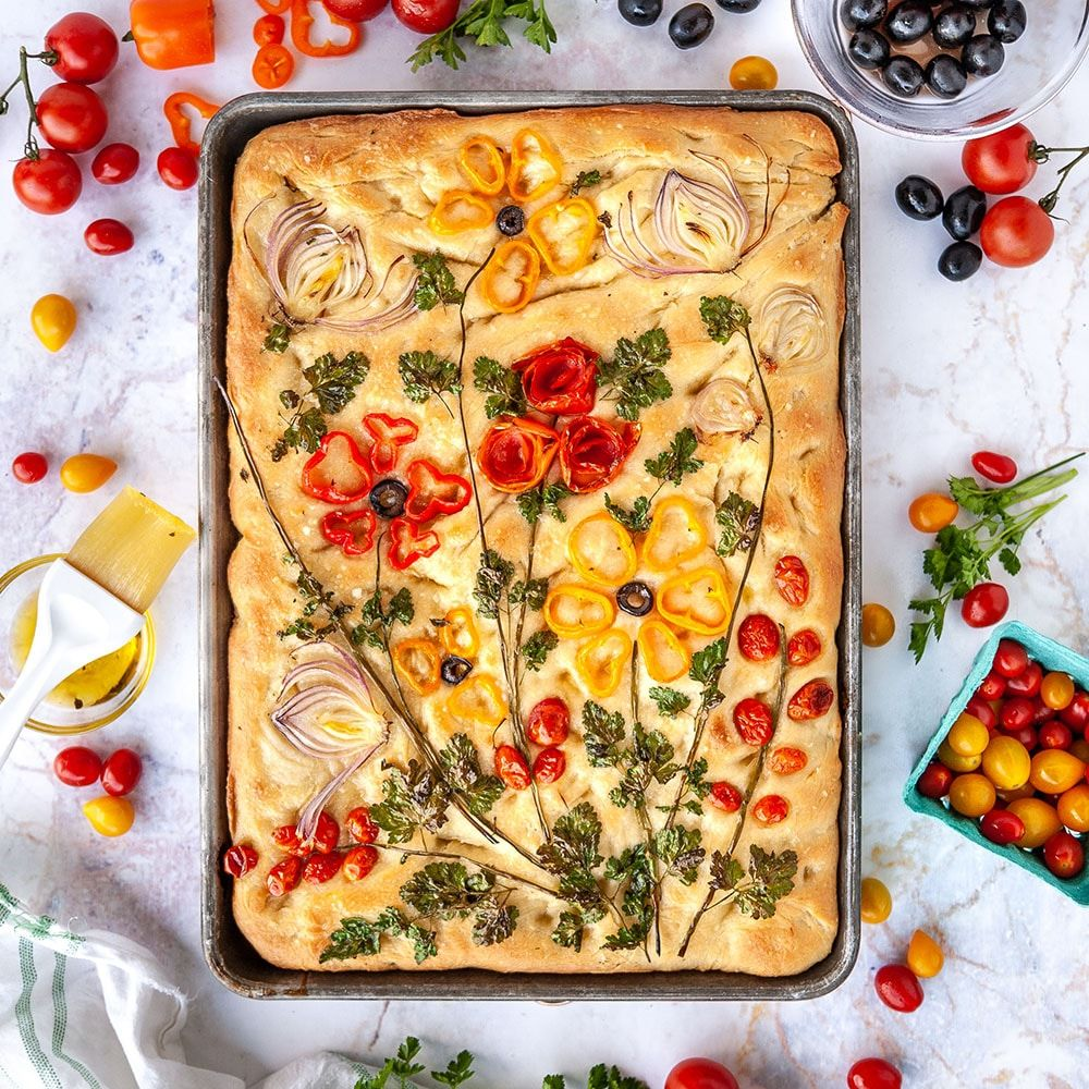 How to make trendy focaccia bread art with vegetables, herbs and meats. Follow this blog post for tips and tricks!
