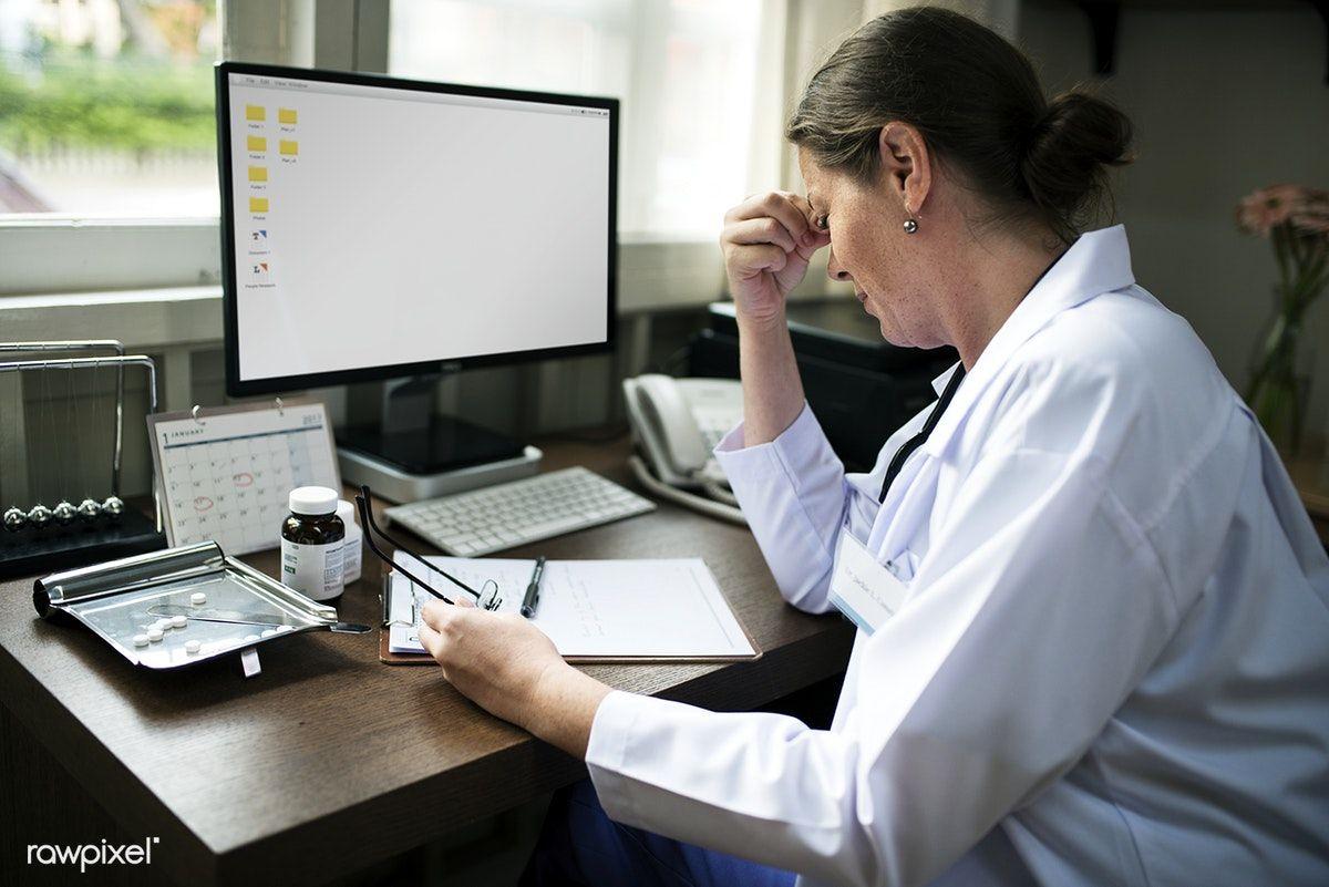 Download premium image of Doctor writing a prescription 259480