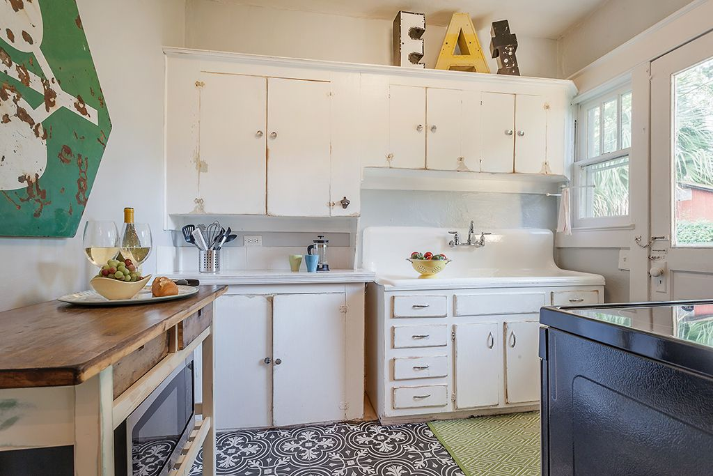 Original kitchen cabinets were distressed while the ...