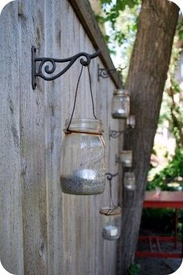 Mason jars hung with sand and a votive candle